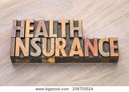 health insurance word abstract in in vintage letterpress wood type