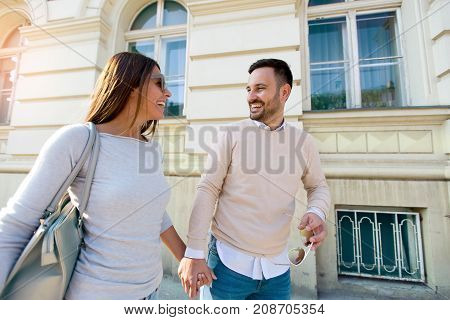 Smiling couple in love outdoors.Young happy couple walking on the city street.