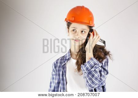 Beautiful girl in a helmet. Woman using headphones
