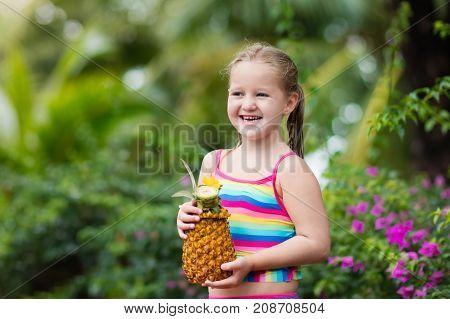Child Drinking Juice In Swimming Pool Bar