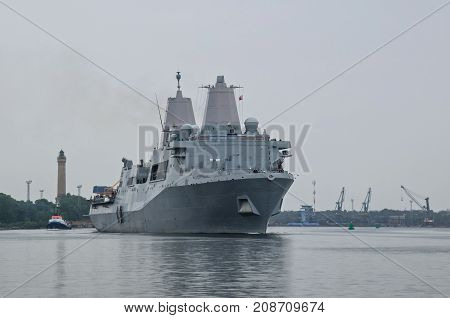 LANDING CRAFT -  An American warship sails out of the harbor
