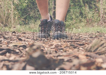 Woman Hiking on Trail with hiking shoes