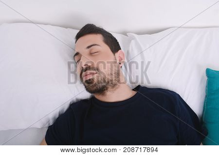 Man Sleeping On Bed.