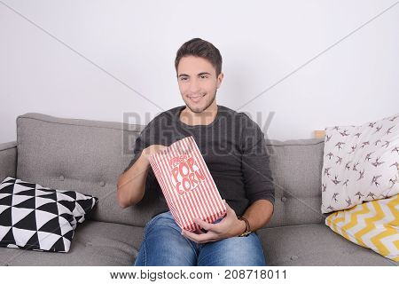 Man Eating Popcorn And Watching Movies.