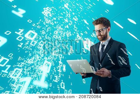 Attractive young businessman using laptop on blue background with abstract binary code. Technology concept