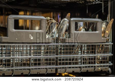 Dishwasher With Dirty Dishes. Powder, Dishwashing Tablet And Rinse Aid.