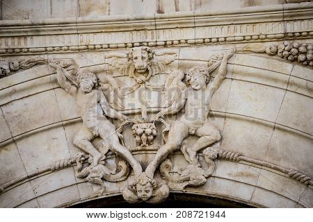 Historic details of stone sculptures of the facade of the University of Alcalá de Henares. Madrid, Spain