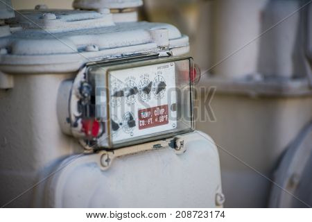 Natural Gas Meter Outside Residential House Close up