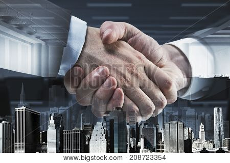 Side view and close up of abstract handshake on city office background. Partnership concept. Double exposure