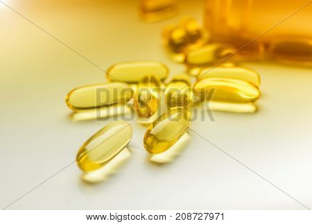 Cod liver oil omega 3 gel capsules isolated on white sunny background