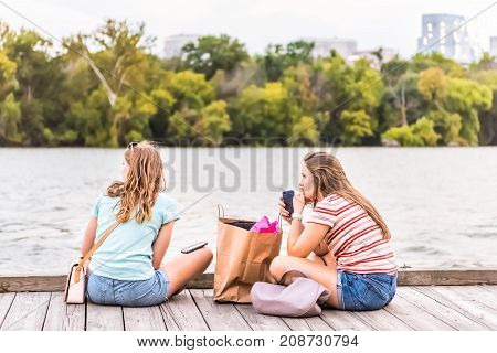 Washington Dc, Usa - August 4, 2017: Two Girl Friends University Students Sitting In Georgetown Park