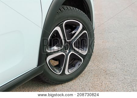 tire and alloy wheel on this small passenger car