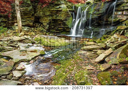 Elakala Waterfall In Blackwater Falls State Park In West Virginia During Autumn With Red Leaves Foli