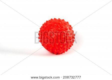 Red massage stress ball on white background