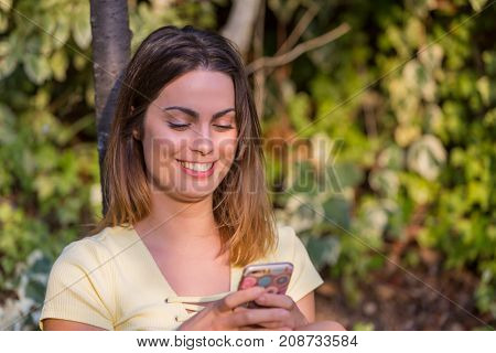 young beautiful woman on the phone, outdoor