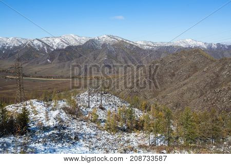 View of the snowy landscape of the Altay Mountains near the village of Onguday, Altai Republic, Russia.