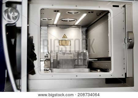A model with supports created in a laser sintering machine stays in the working chamber. DMLS SLM SLS technology. Concept of 4.0 industrial revolution. Progressive modern additive technology.