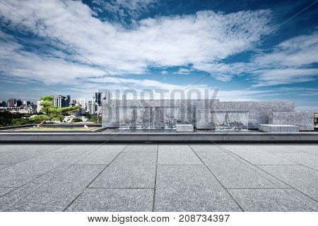 empty square wity artificial waterfall and cityscape of kuala lumpur