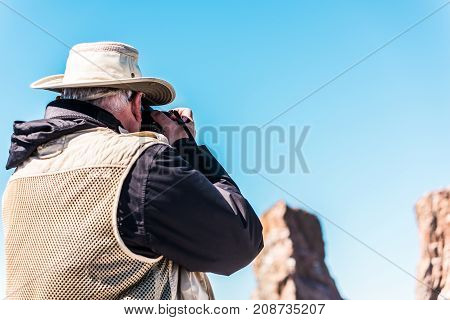 Perce, Canada - June 6, 2017: Senior Old Photographer Man Taking Photo Picture On Boat Of Rocher Per