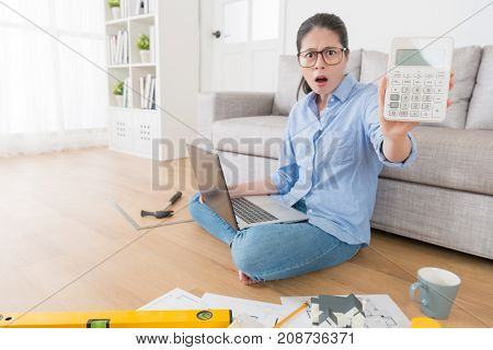 Beauty Attractive Woman Showing Calculator Tool