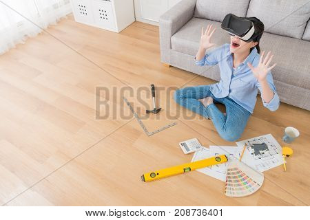 Woman Wearing Vr Technology Sitting On Floor