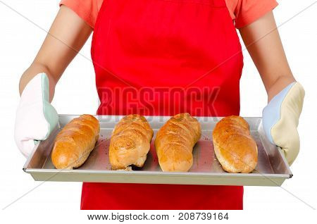 French bread (baguette) on baking tray holding by woman hand, homemade bakery cooking