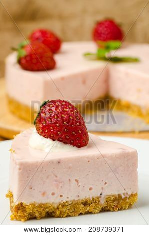 Piece of strawberry cheesecake on dish, Homemade bakery