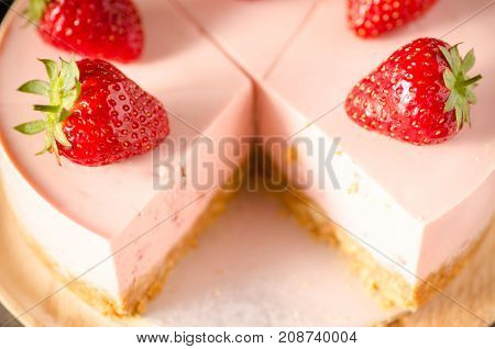 Sliced strawberry cheesecake, Homemade bakery cooking. Delicious cake