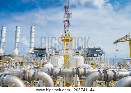 Oil and gas central processing platform at the top of deck floor where located gas dehydration compressor and telecommunication system.