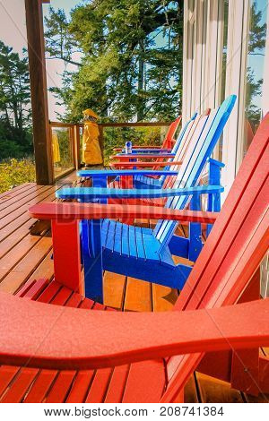 UCLUELET, BC - JULY 6, 2015 - Red and blue sun chairs on the porch on July 6, 2015, in Ucluelet.