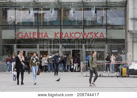 Galeria Krakowska shopping centre main square with entry Cracow Poland - October 13 2017: People come in and out to Galeria Krakowska shopping centre Cracow Poland.