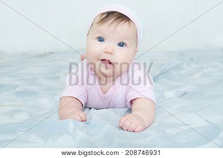Happy smiling baby girl portrait with wryneck. Health care lifestyle.