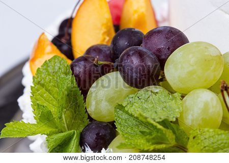 Grapes and peach slices on white background