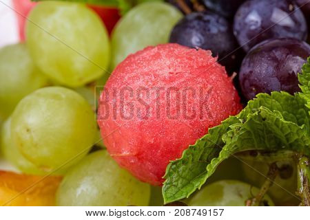 Fruit platter - grapes and watermelon, closeup photo