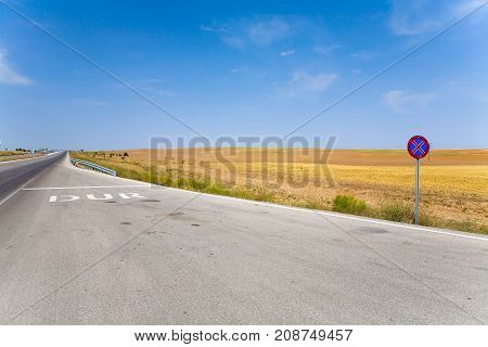 Road sign and road markings with stop line. Turkey.