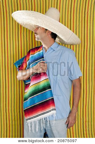 Mexican man serape poncho hat sombrero yellow stripes background