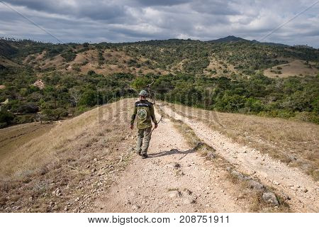 Rinca Island Indonesia - July 25 2017: The guided man at Rinca island Komodo National Park Indonesia.