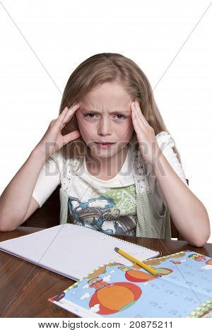Cute Little Girl Having A Hard Time With Her Homework