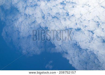 Altocumulus cloudscape on blue sky Beautiful Cirrocumulus white clouds in the sunny day.