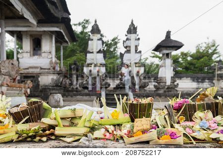 Traditional hindu balinese offerings as flowers money and food in a basket in Pura Penataran Agung Lempuyang Bali Indonesia