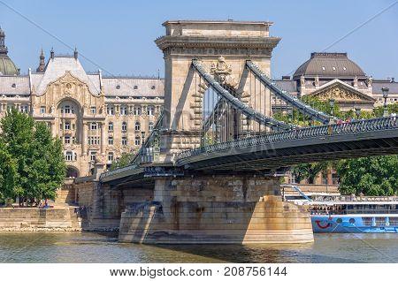 Szechenyi Chain Bridge the Gresham Palace and the Ministry of Interior - Budapest, Hungary, 24 July 2013