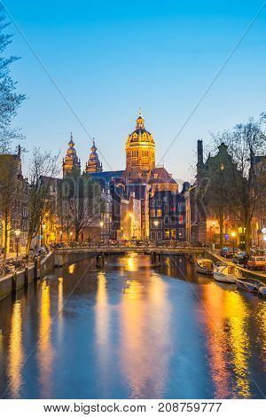 Night In Amsterdam With The Basilica Of St. Nicholas In Amsterdam City, Netherlands