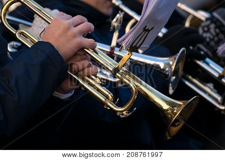 Trumpets of a town band during a performance.