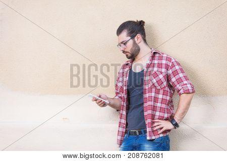 Urban guy using cellphone on the street.