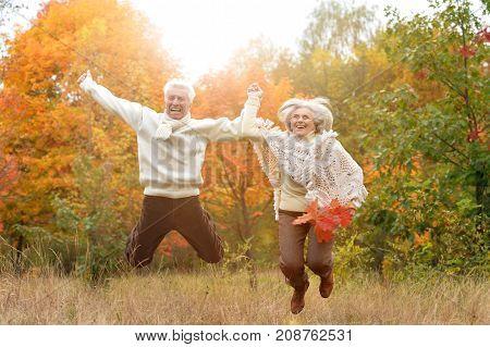 portrait of beautiful caucasian senior couple having fun in park
