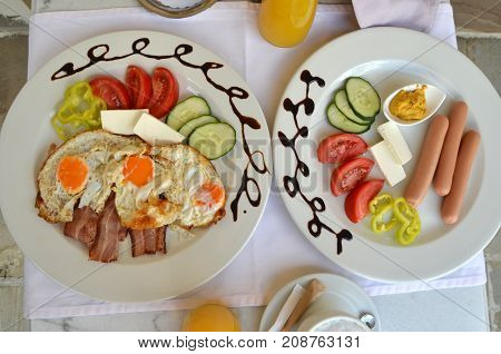 Plates With Served Breakfast