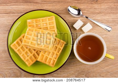 Heap Of Waffles In Plate, Cup Of Tea, Sugar