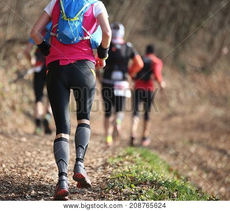 People Run During Country Races In The Woods