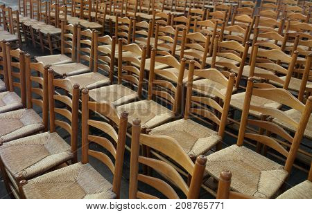 Series Of Empty Chairs With Straw Seat