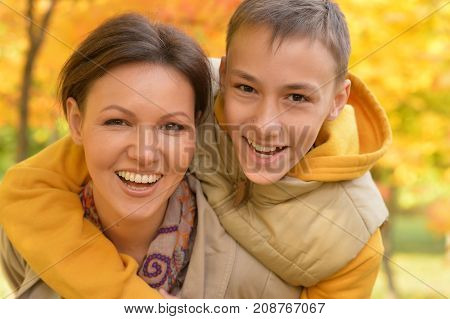 portrait of mother and son having fun outdoors